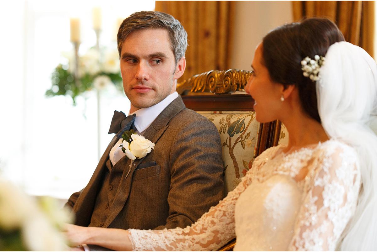 groom looks lovingly at bride
