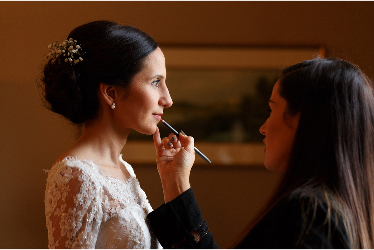 Bride gets lipstick touched up