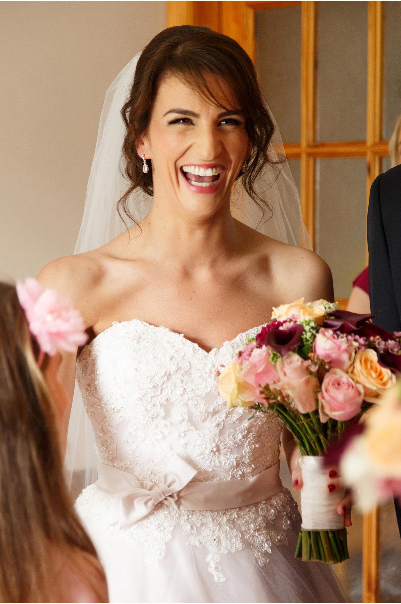 stunning bride enjoys her familys reaction to her dress