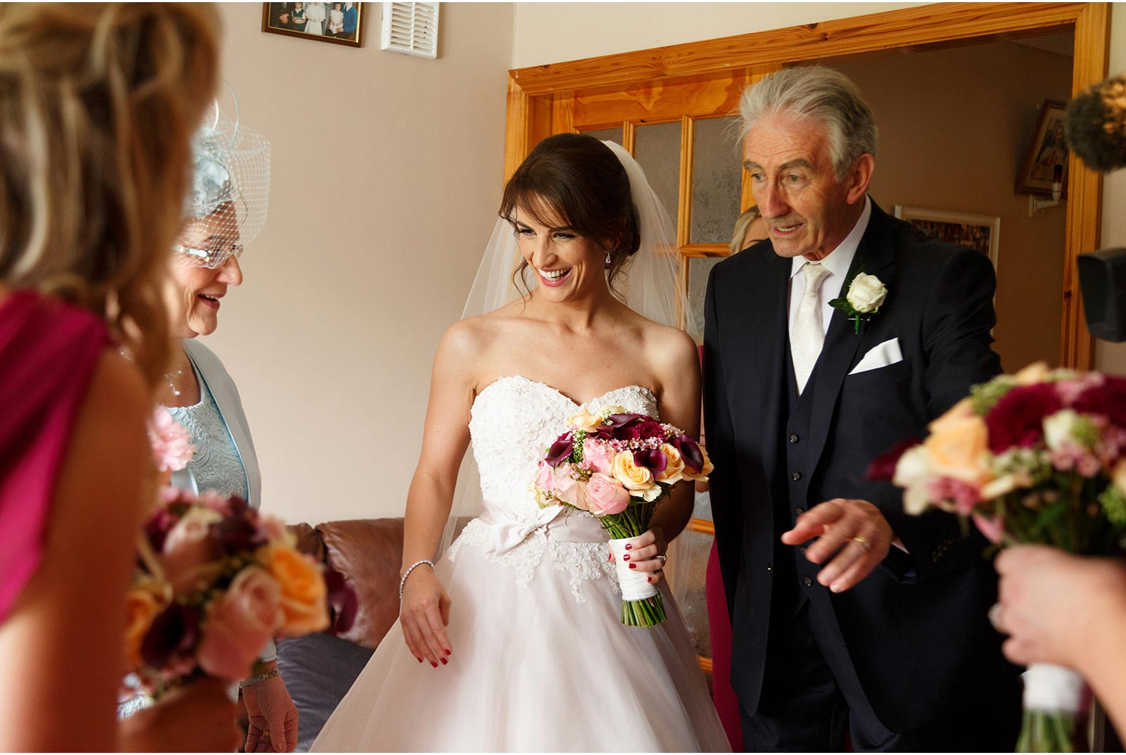 bride with dad and family at home