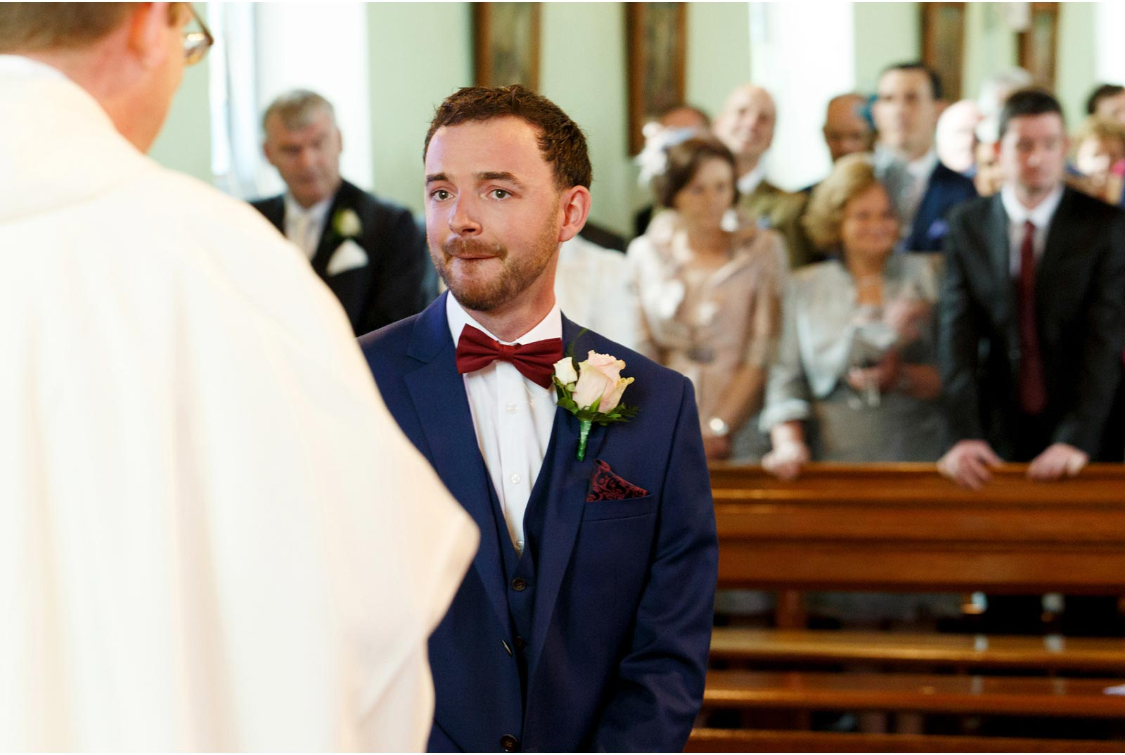 emotional groom has just caught a glimpse of his bride