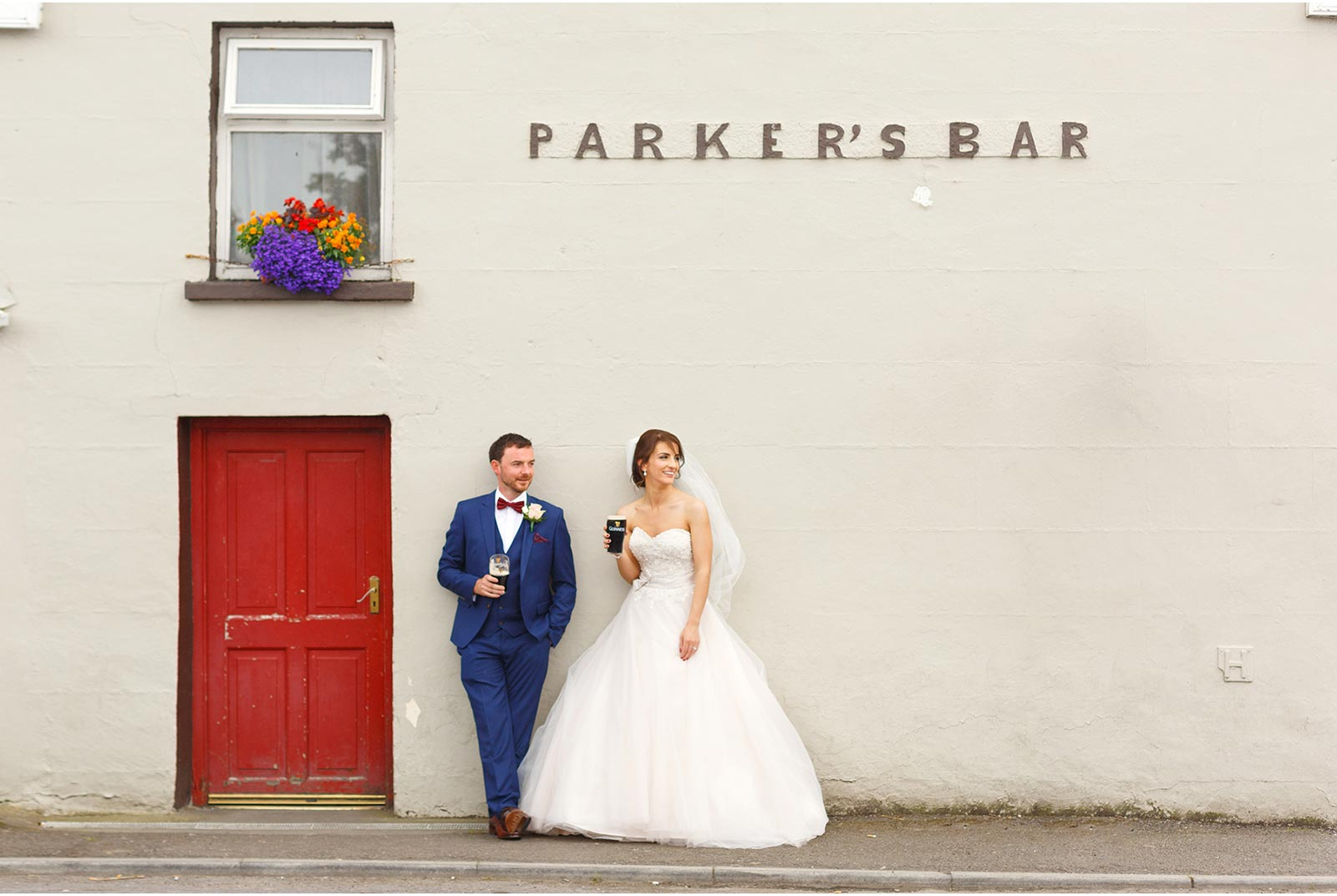 bride and groom have a pint of guiness outside parkers bar in Kilflynn Co Kerry wedding