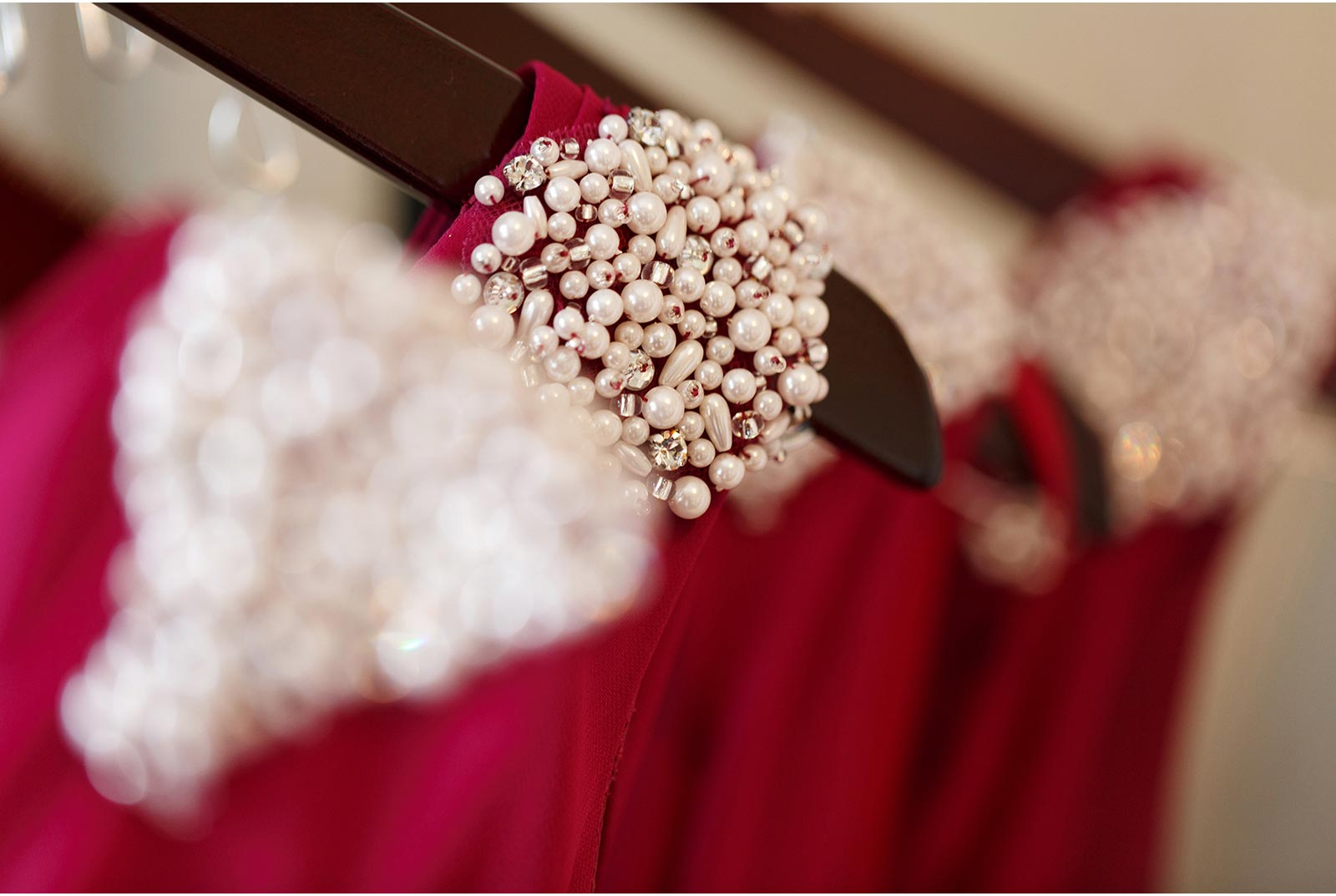 row of bridesmaids dresses with ornate beading on the shoulder