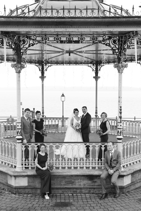 bridal party at the band stand in Cobh by wedding photographer Claire O'Rorke
