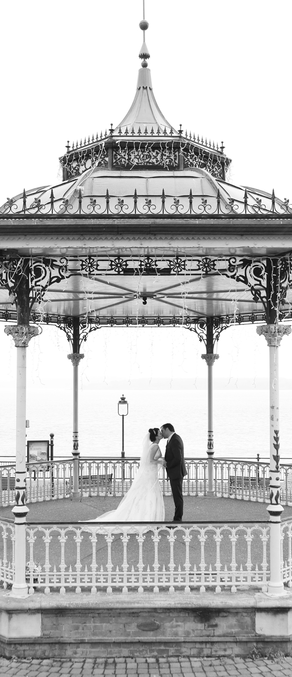 Bride and groom kiss under the bandstand after their wedding in Cobh Cathedral