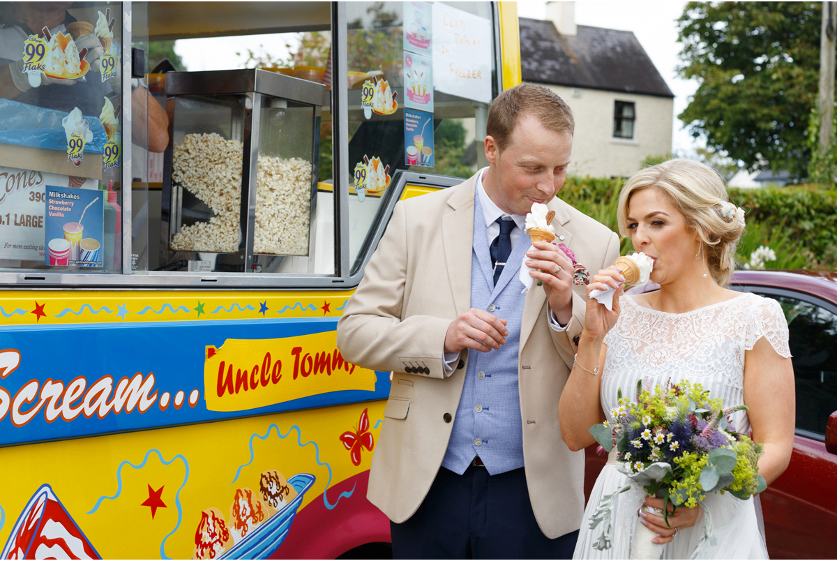 bride and groom with ice cream cones