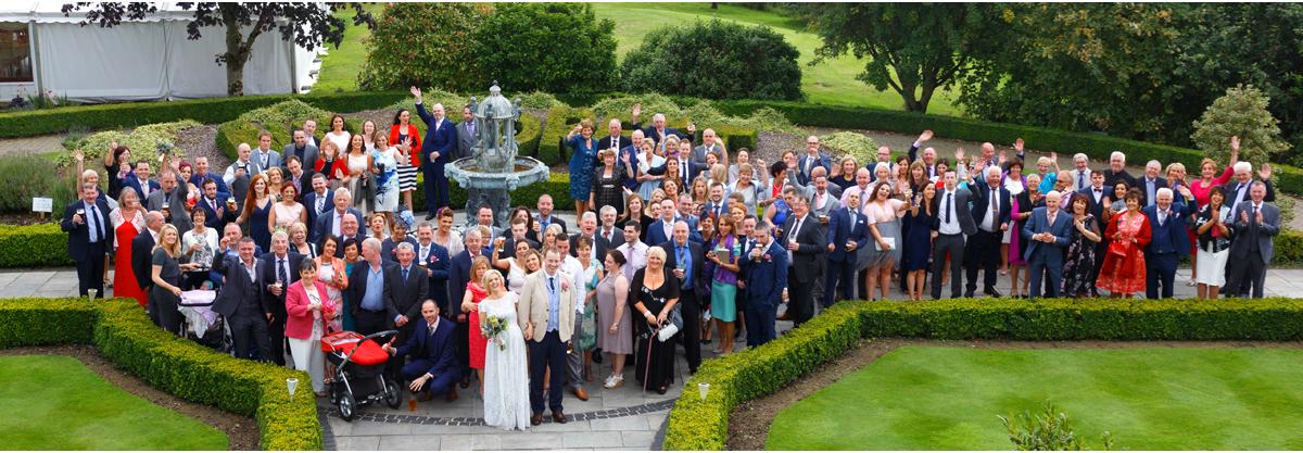 big group photo at Irish wedding