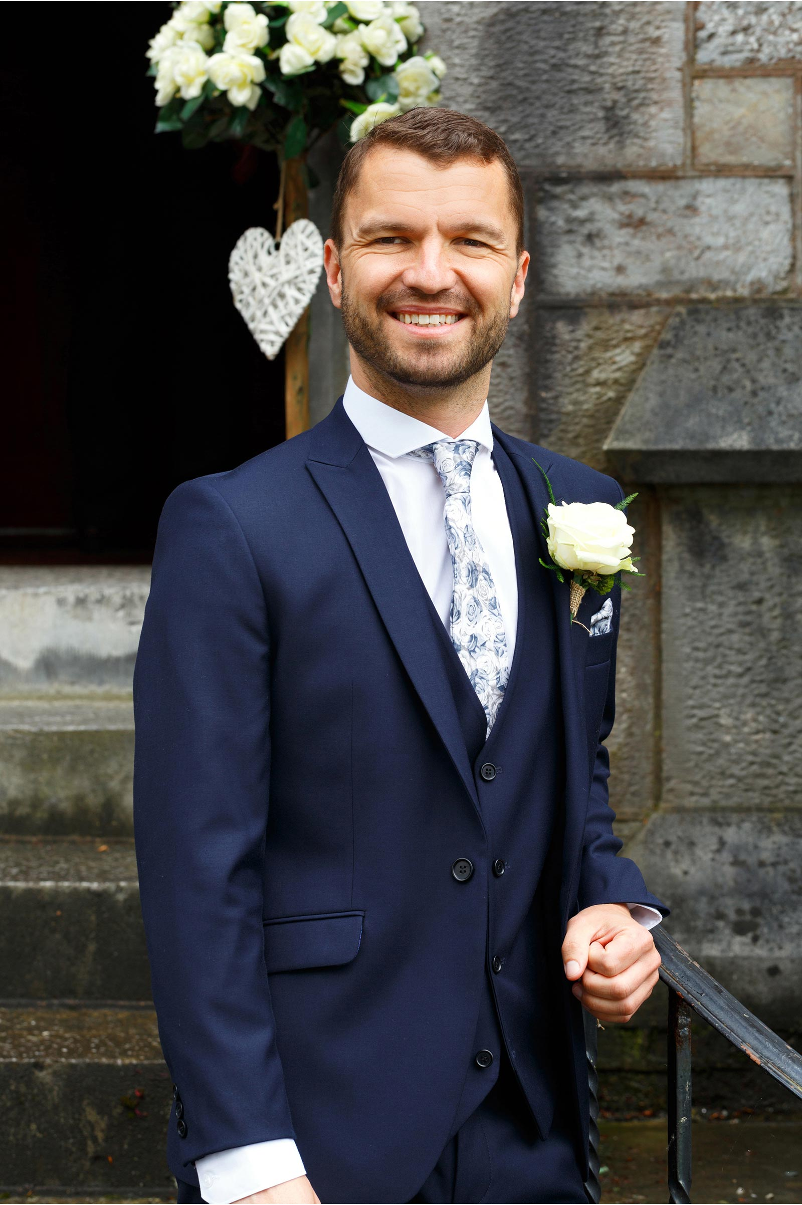 three piece suit on groom at the Aula Maxima UCC wedding