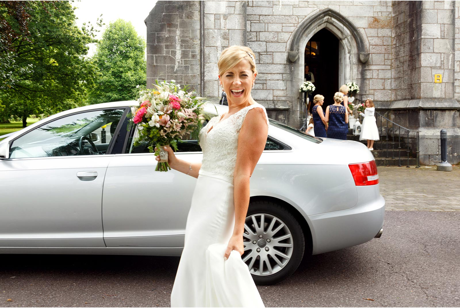 Arriving at UCC's Aula Maxima for her wedding, fun wedding photography, Cork