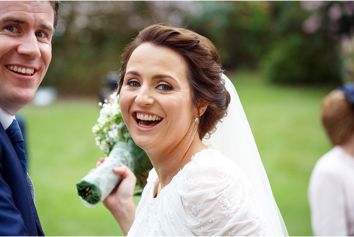 Candid wedding photography bride laughing at Marybrough House