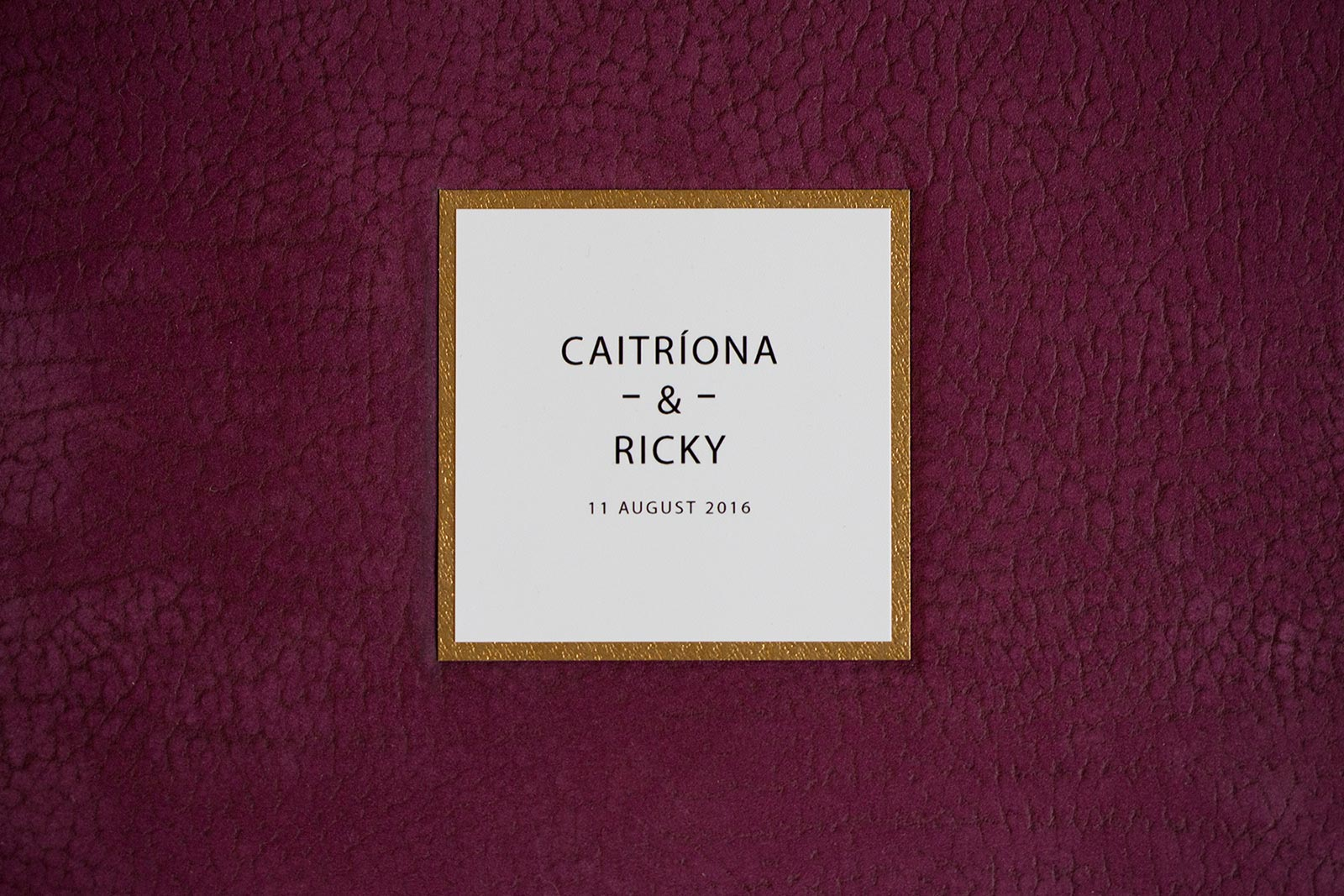 Queensberry wedding album with contemporary leather in plum