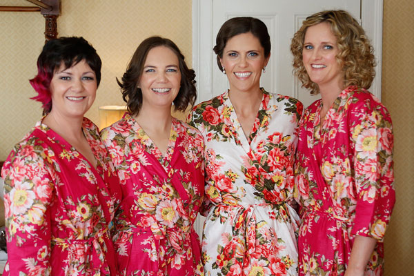 bridesmaids in their floral dressing gowns