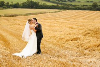 Barnabrow wedding photographer Claire O'Rorke hayfield kiss