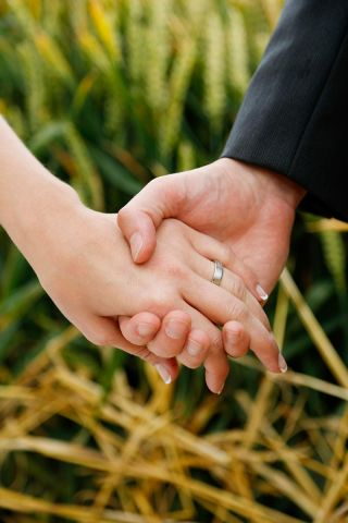 holding hands - wedding photographer Cork