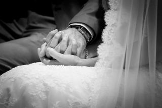 holding hands - Honan chapel wedding - discreet wedding photographer Cork