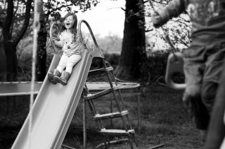 Candid child photography - kids at home - Sophie Belle on slide