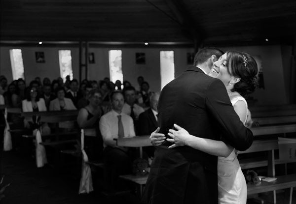 black and white photograph of a bride and groom hugging after they have just been married at Fossa church taken by female wedding photographer claire o'rorke