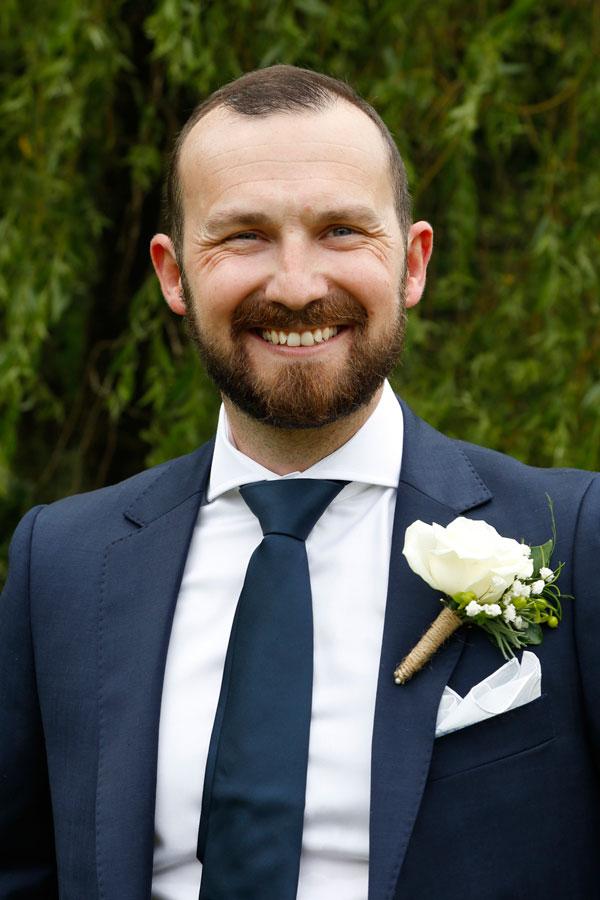 groom in navy