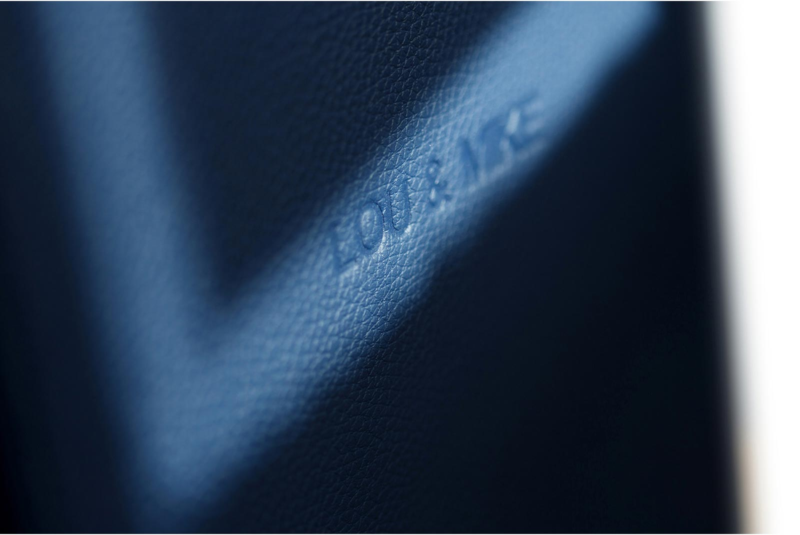 Embossed names on Royal blue wedding album