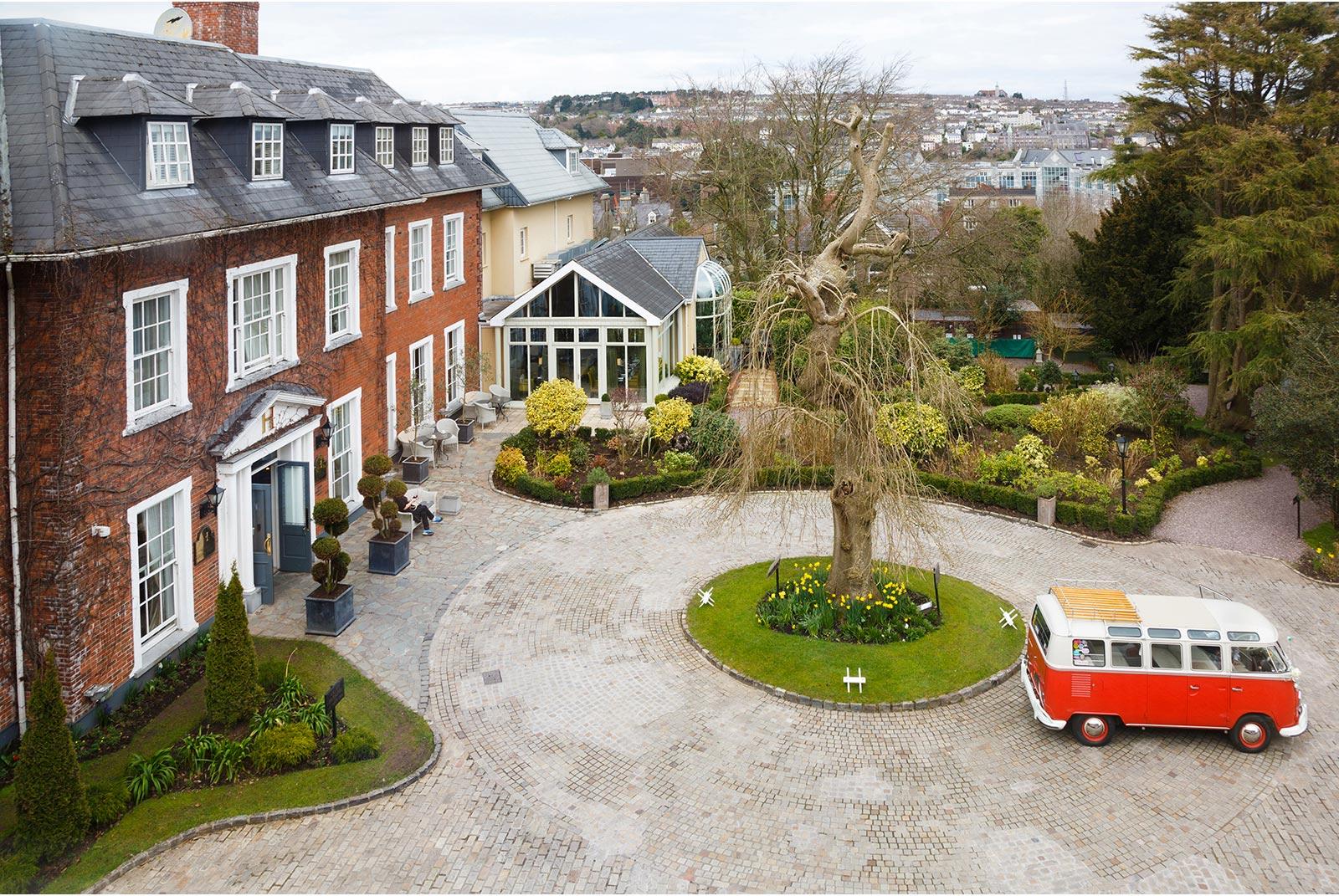 Red VW camper van wedding car at Hayfield Manor