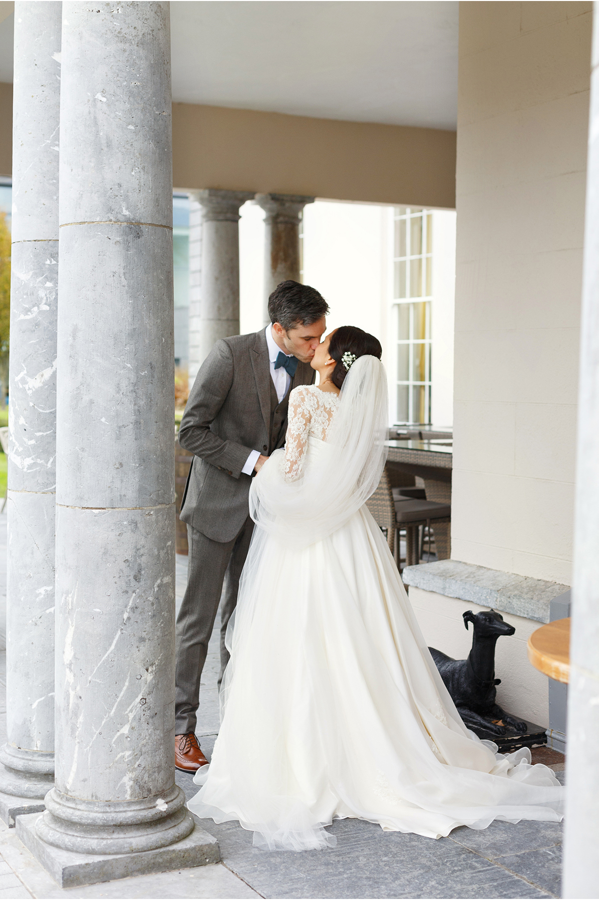couple kiss at Castlemartyr wedding