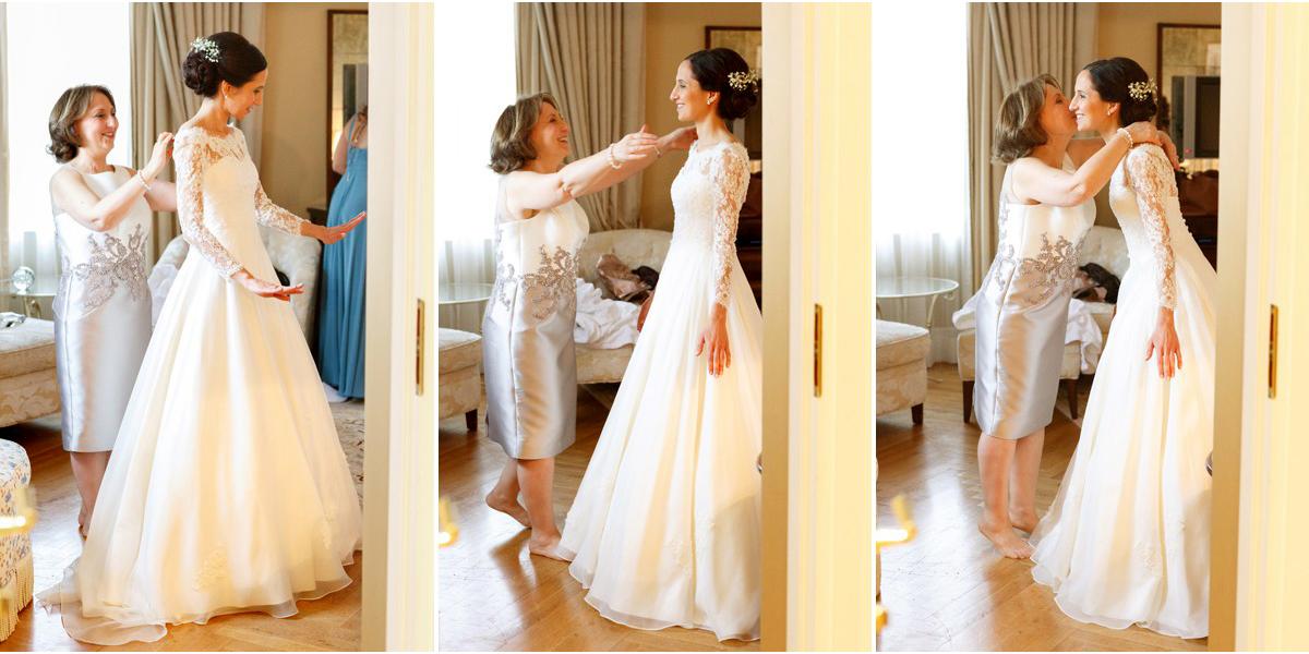 mother helps dress bride
