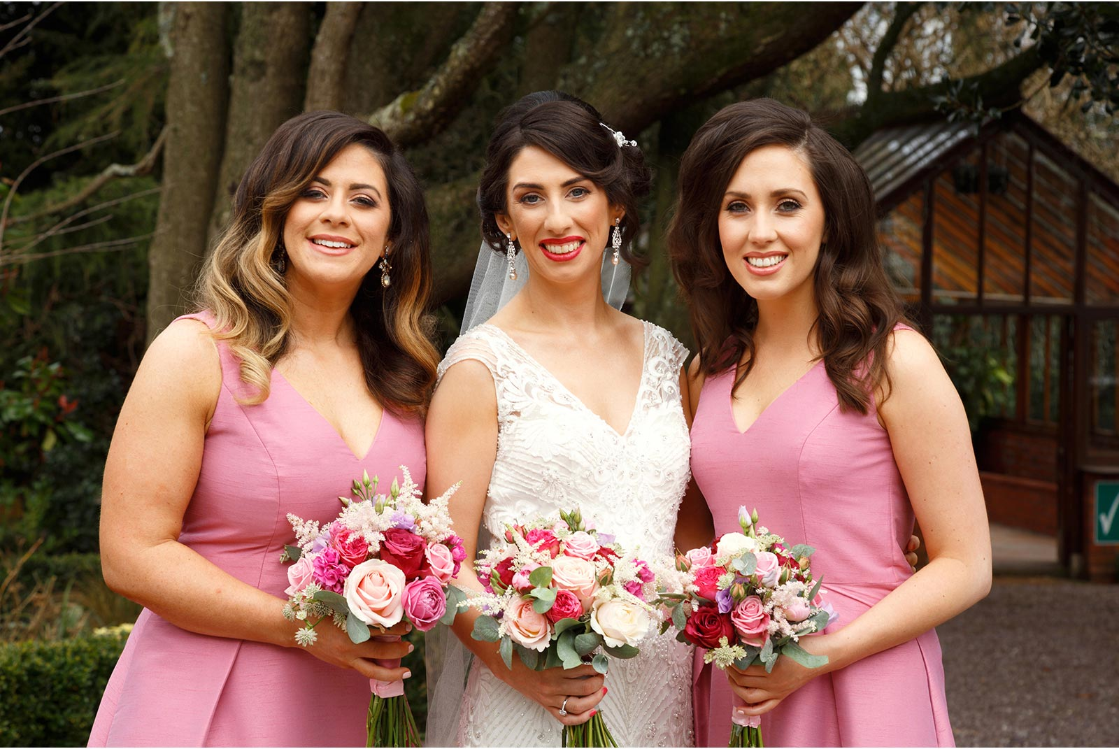 bridesmaids in pink with bride