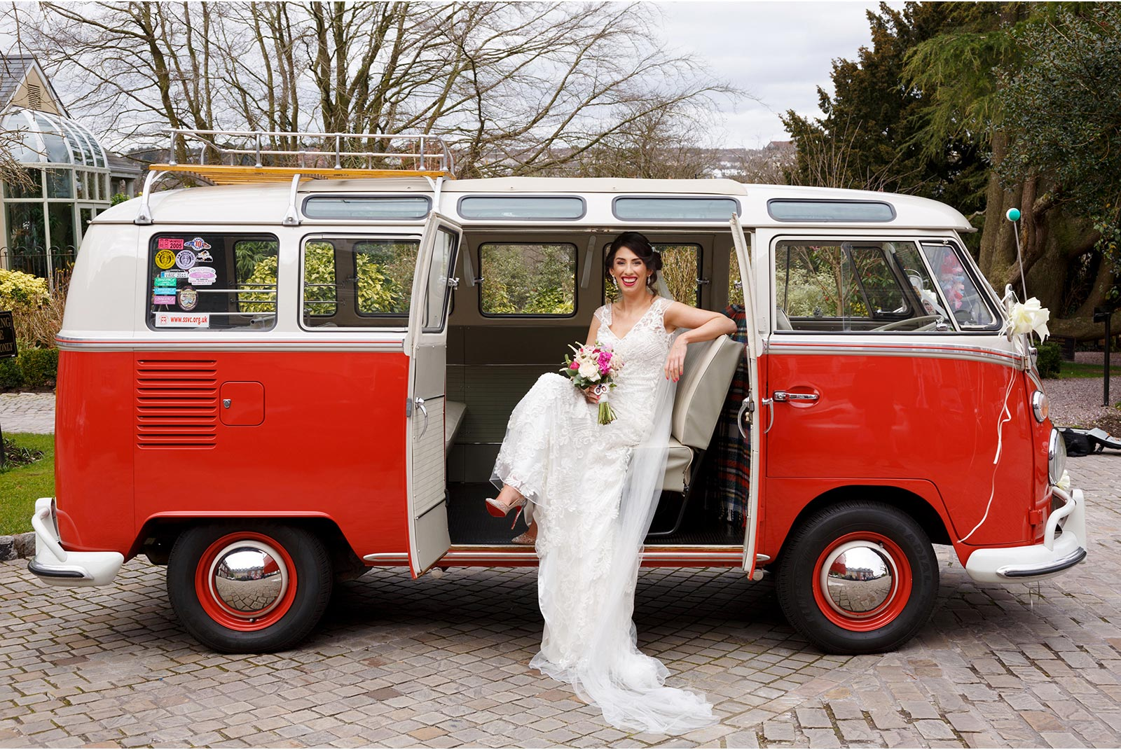 Bride enjoying her red VW camper wedding bus