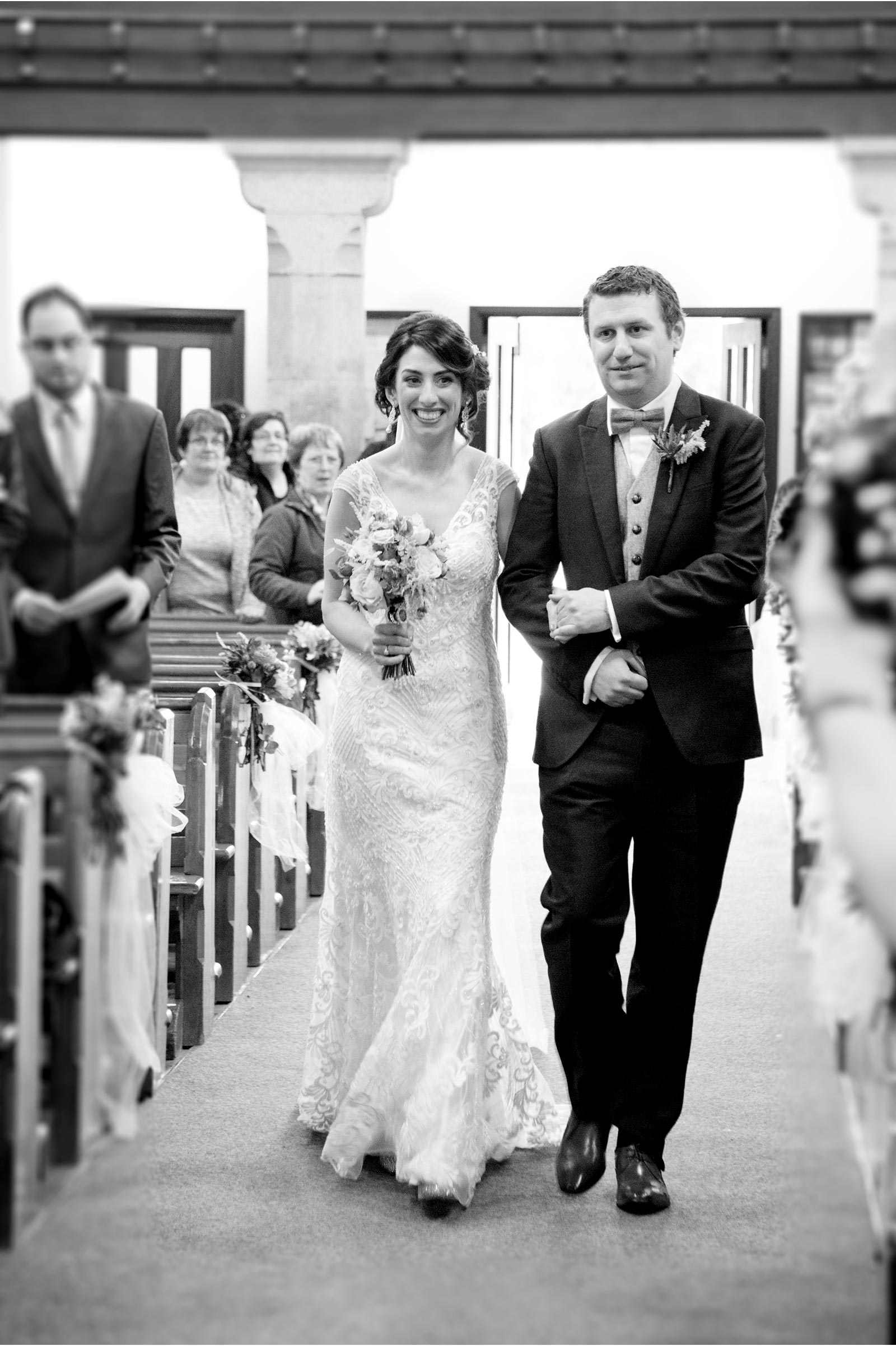 brother walks his sister up the isle
