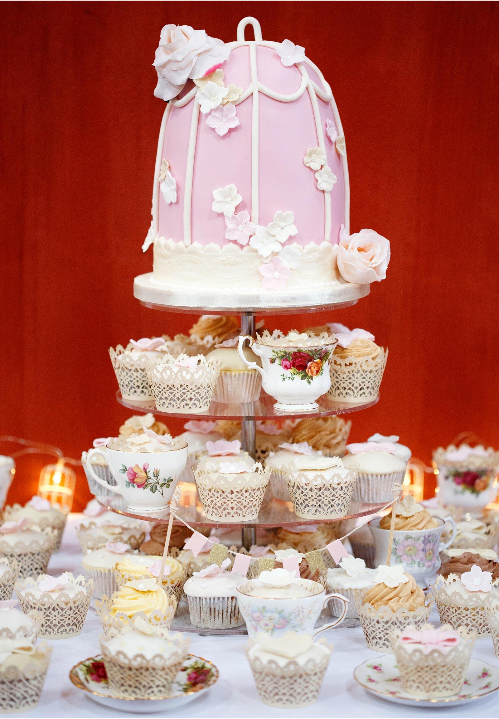 Pink bird cage wedding cake