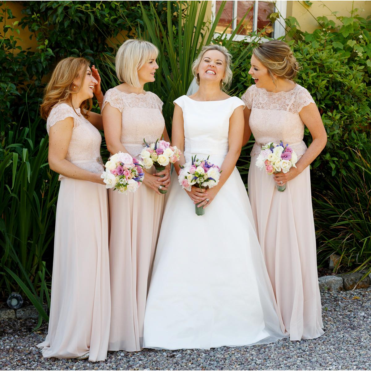 Bride and Bridesmaids laugh at Ballinacurra House fun wedding photographs