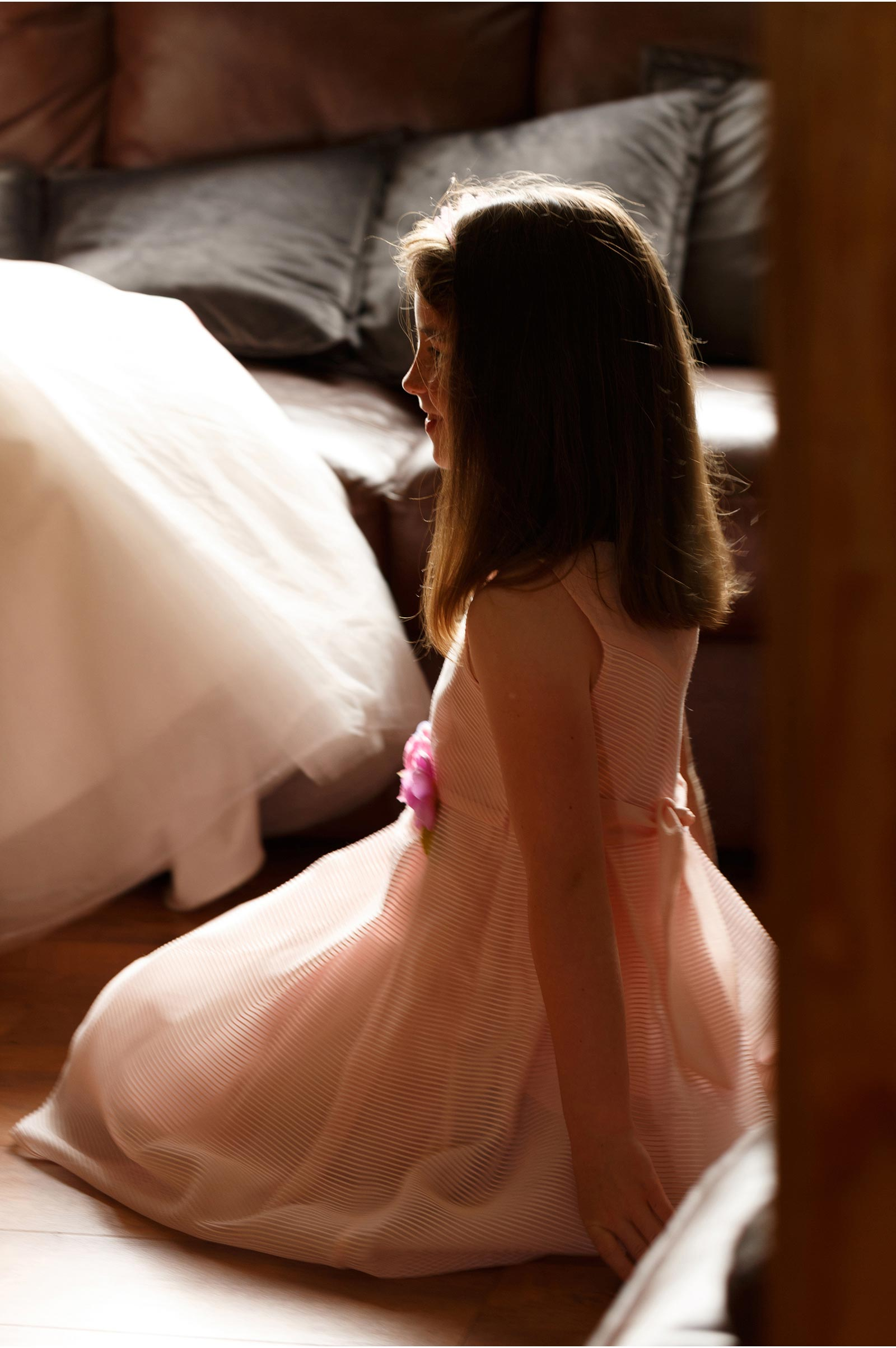 young girl kneels before her aunt the bride