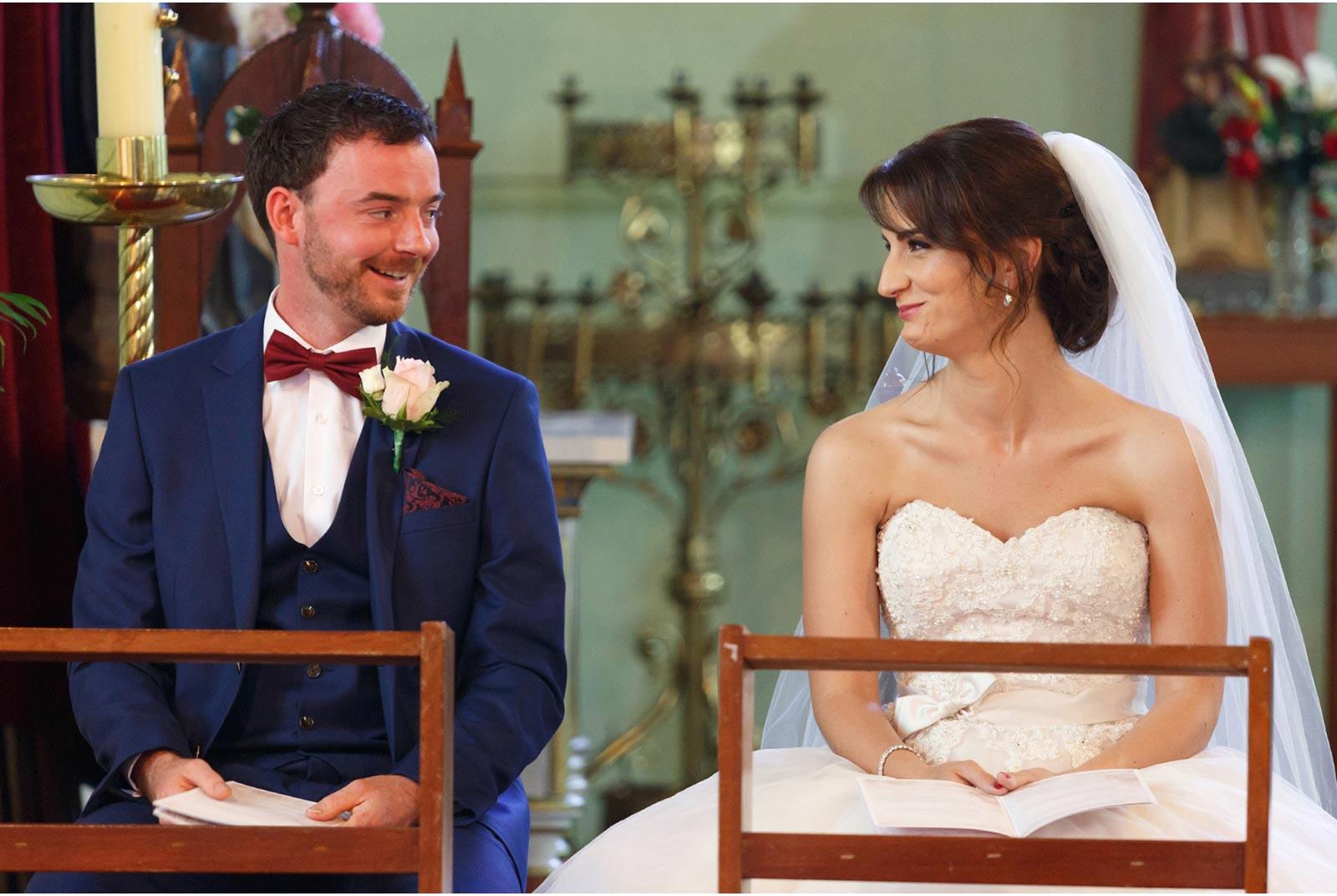 bride an groom exchange a big smile
