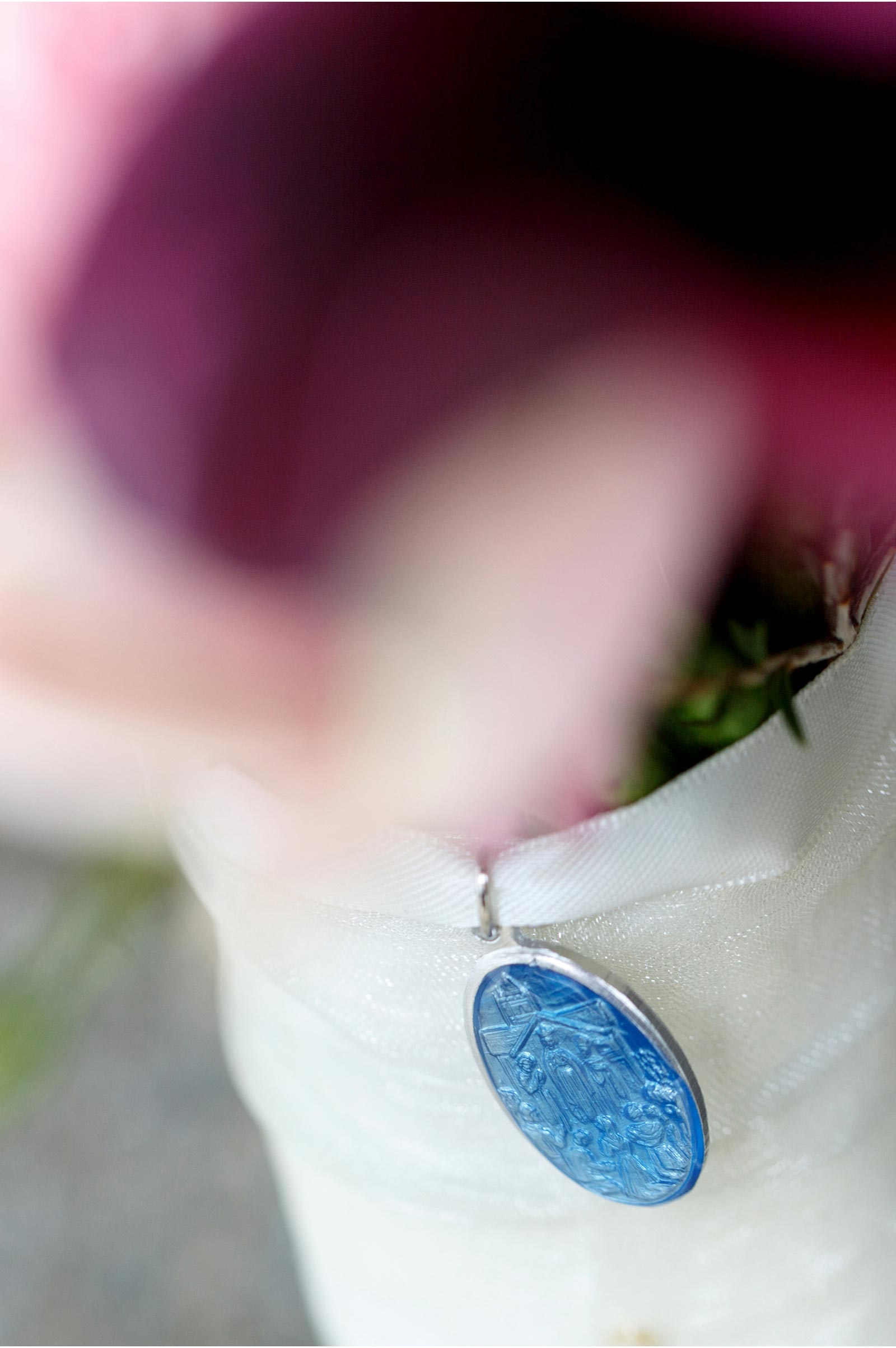 A very common site at an Irish wedding, a miraculous medal attached to the bridal bouquet