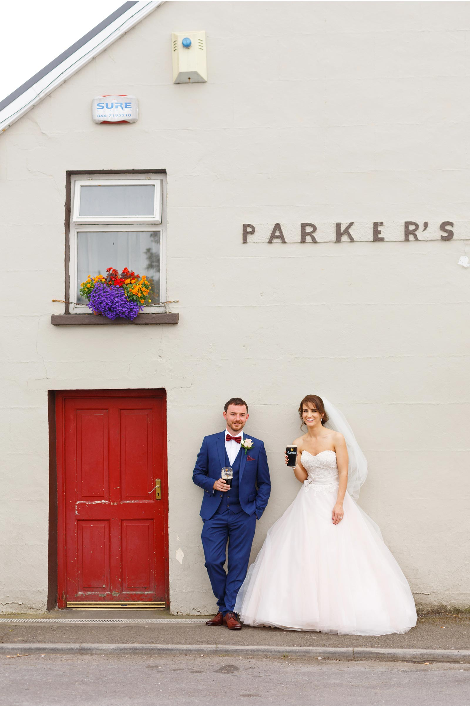 Bride and groom having a lovely pint of guiness outside parkers bar in Kilflynn County Kerry