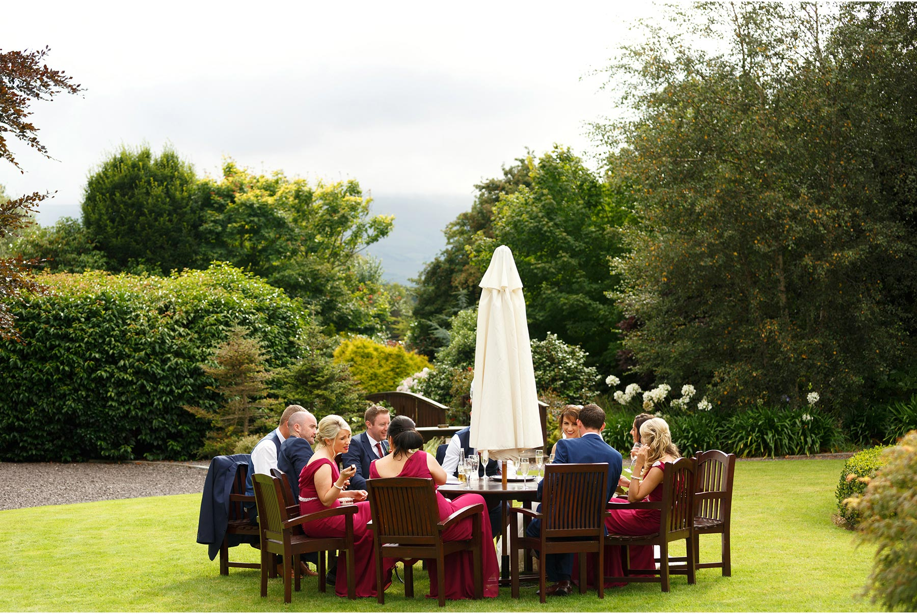 Bridal party chilling out in the gardens of Ballygarry House in Tralee at this Kerry wedding