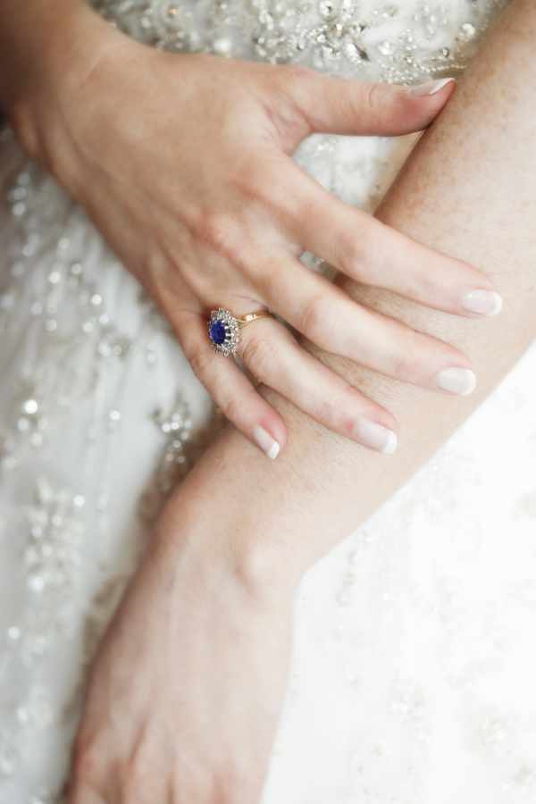 beautiful blue engagement ring on brides hand