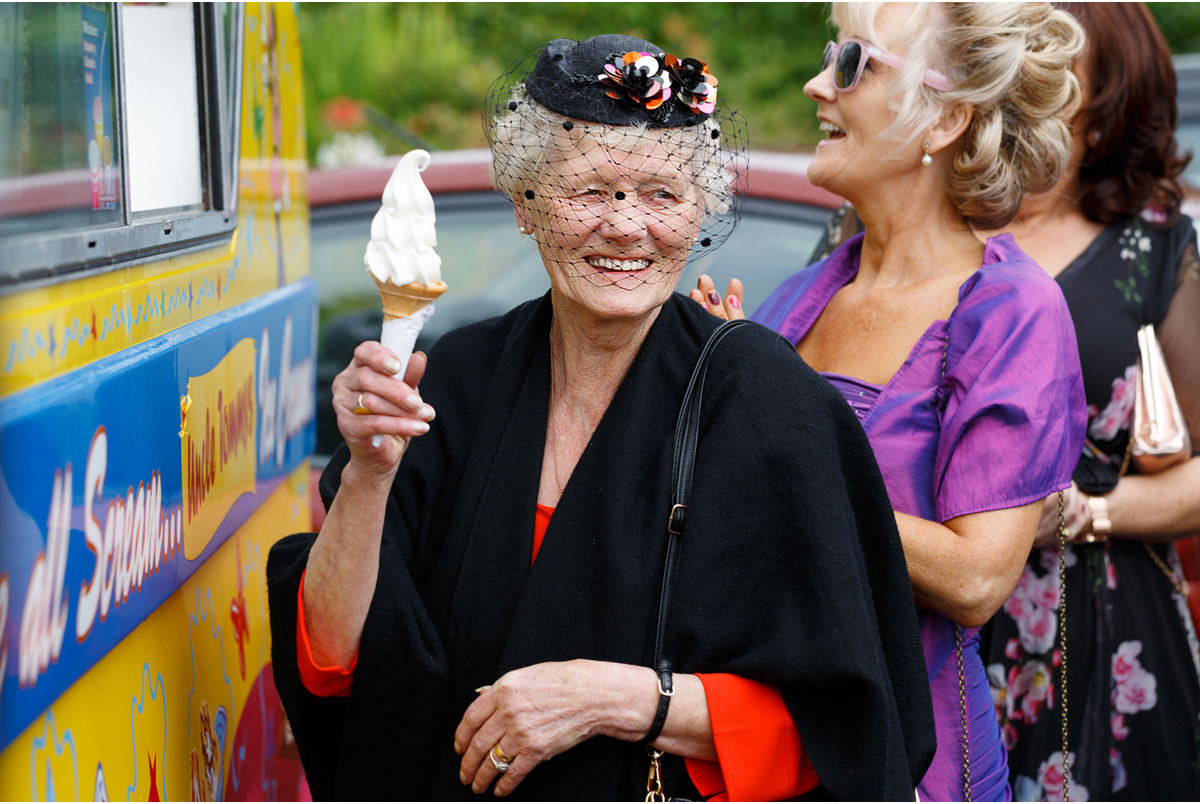 elderly lady happy to have an ice cream cone
