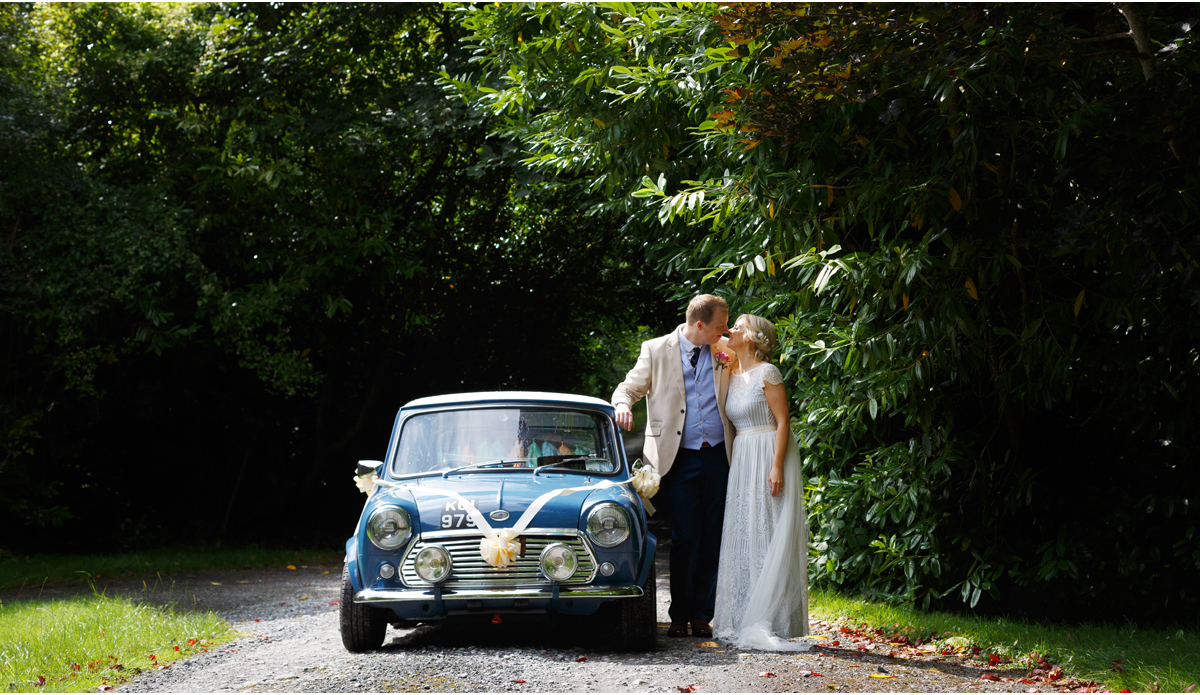 blue mini cooper wedding car