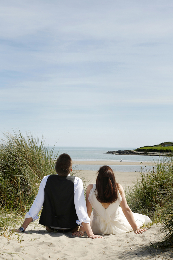 Bride and groom soaking up the sun at Inchydoney beach
