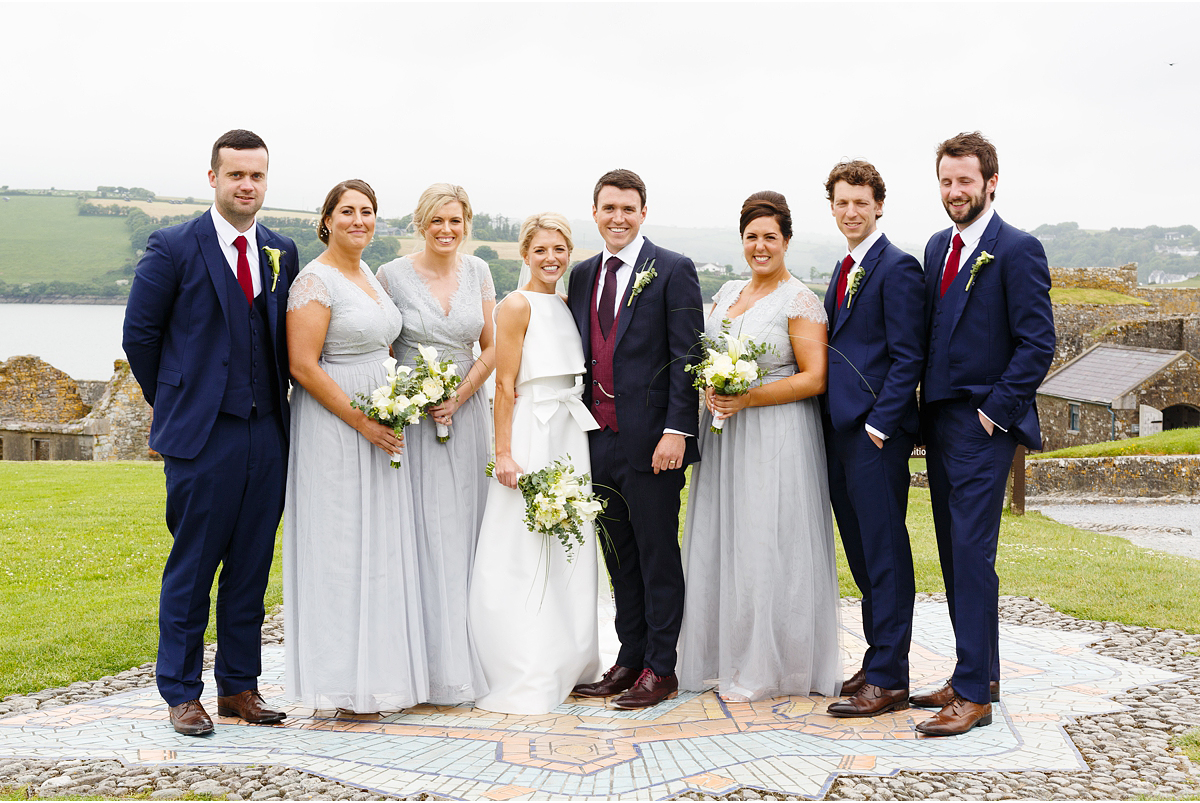 wedding party gathered together in Charles Fort in Kinsale