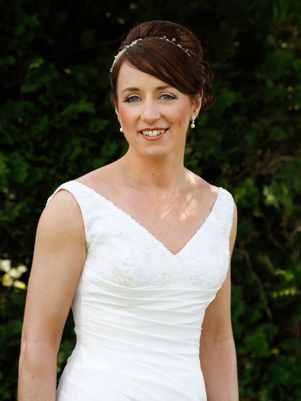 photograph of bride in garden by wedding photographer Claire O'Rorke