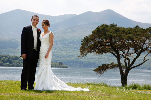 bright sunshiny photograph of a bride and groom at Killarney golf course taken by female wedding photographer claire o'rorke