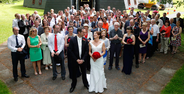 Group photograph taken outside Fossa church by female wedding photographer claire o'rorke