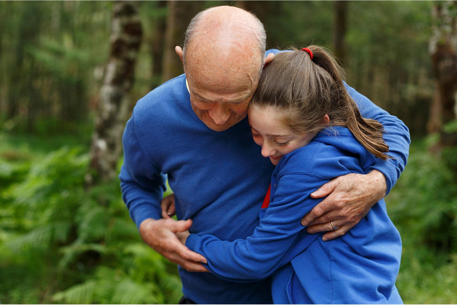 grandfather and grandchild embrase