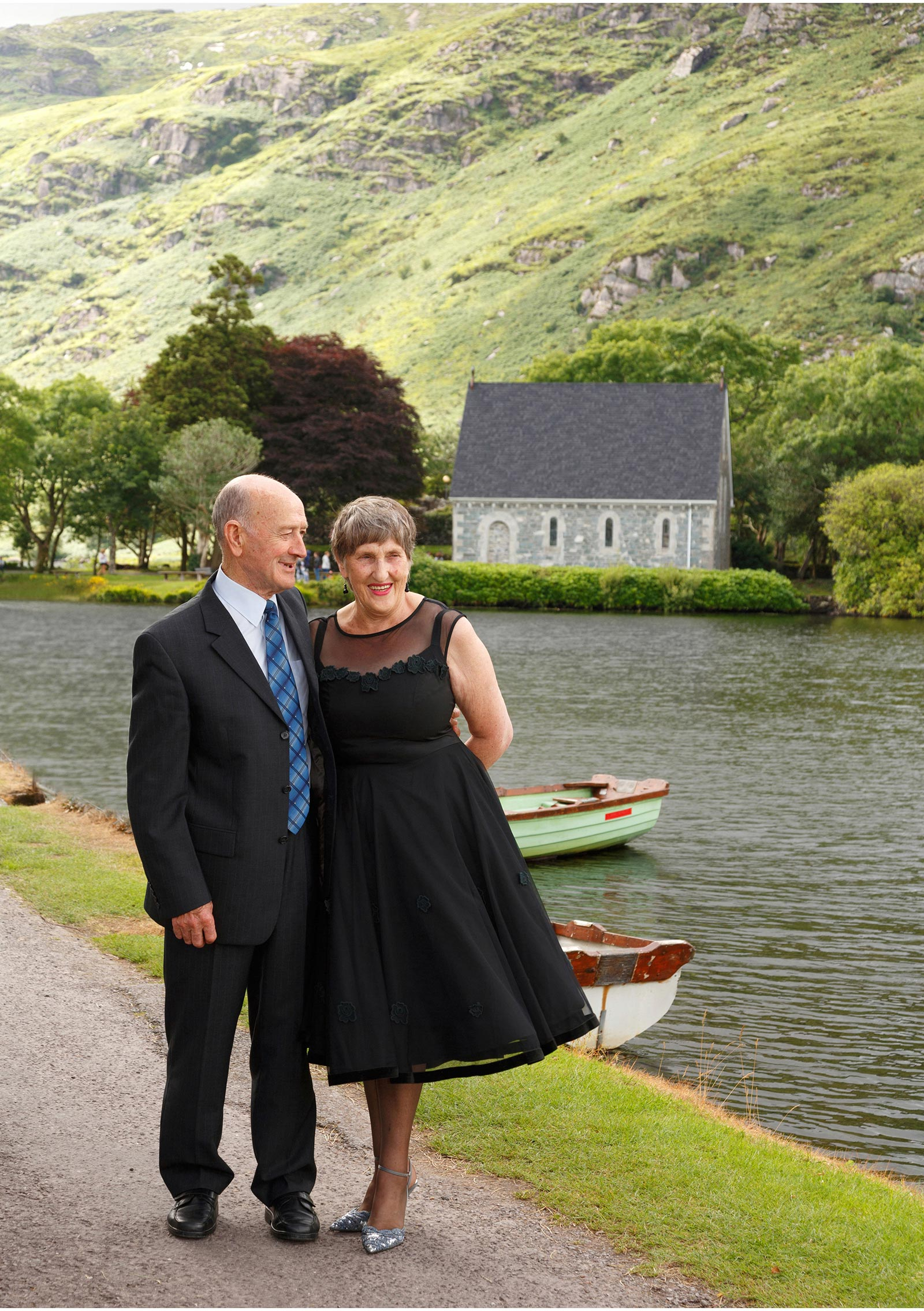 stylish couple pose at Gougane Barra and share a laugh. They are celebrating their 50th wedding anniversary