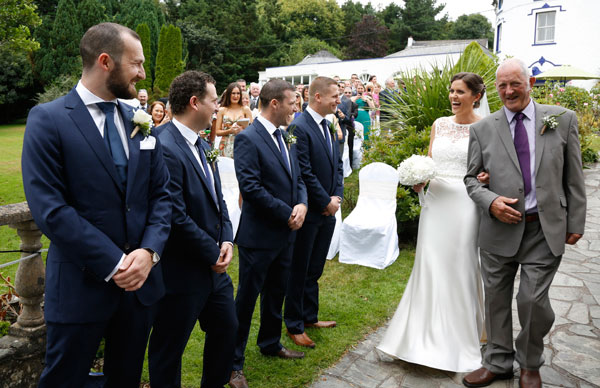 father gives bride away at an outdoor wedding at Innishannon