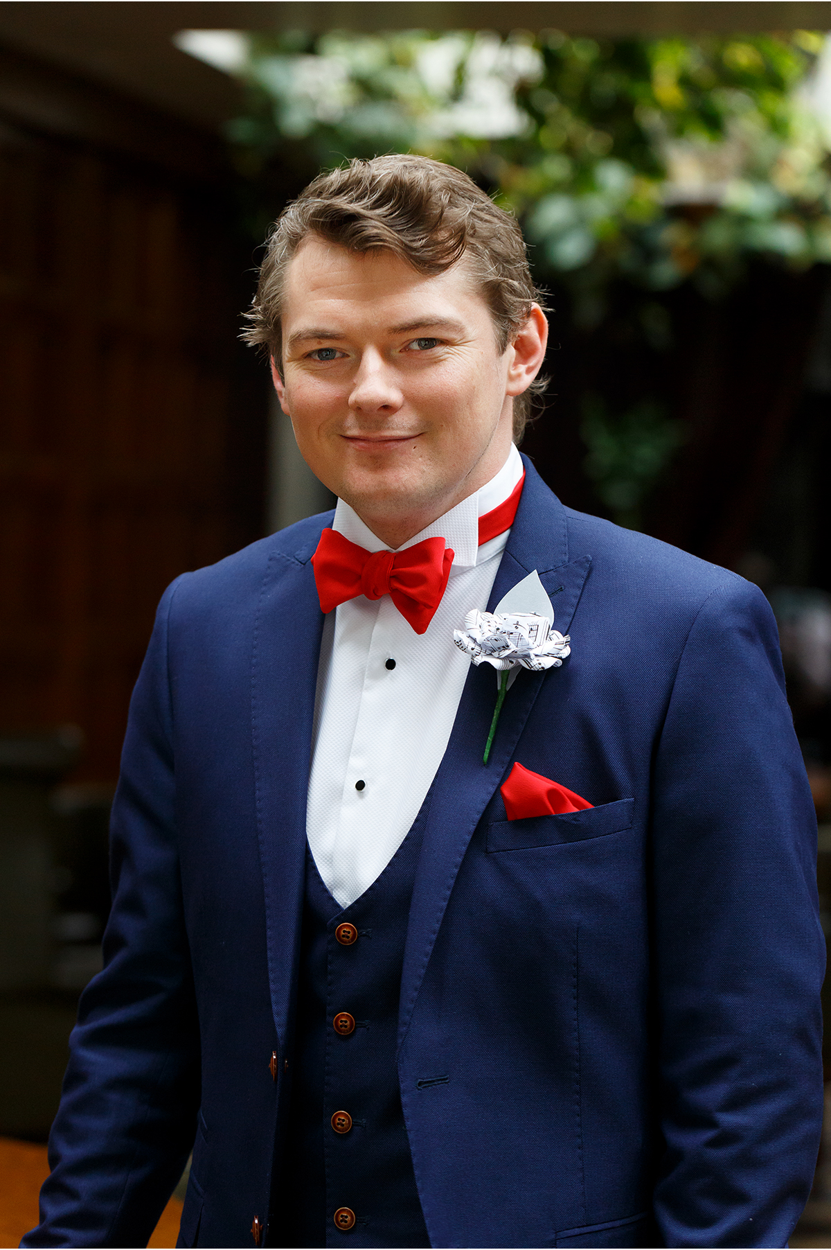 groom - red bowtie navy suit