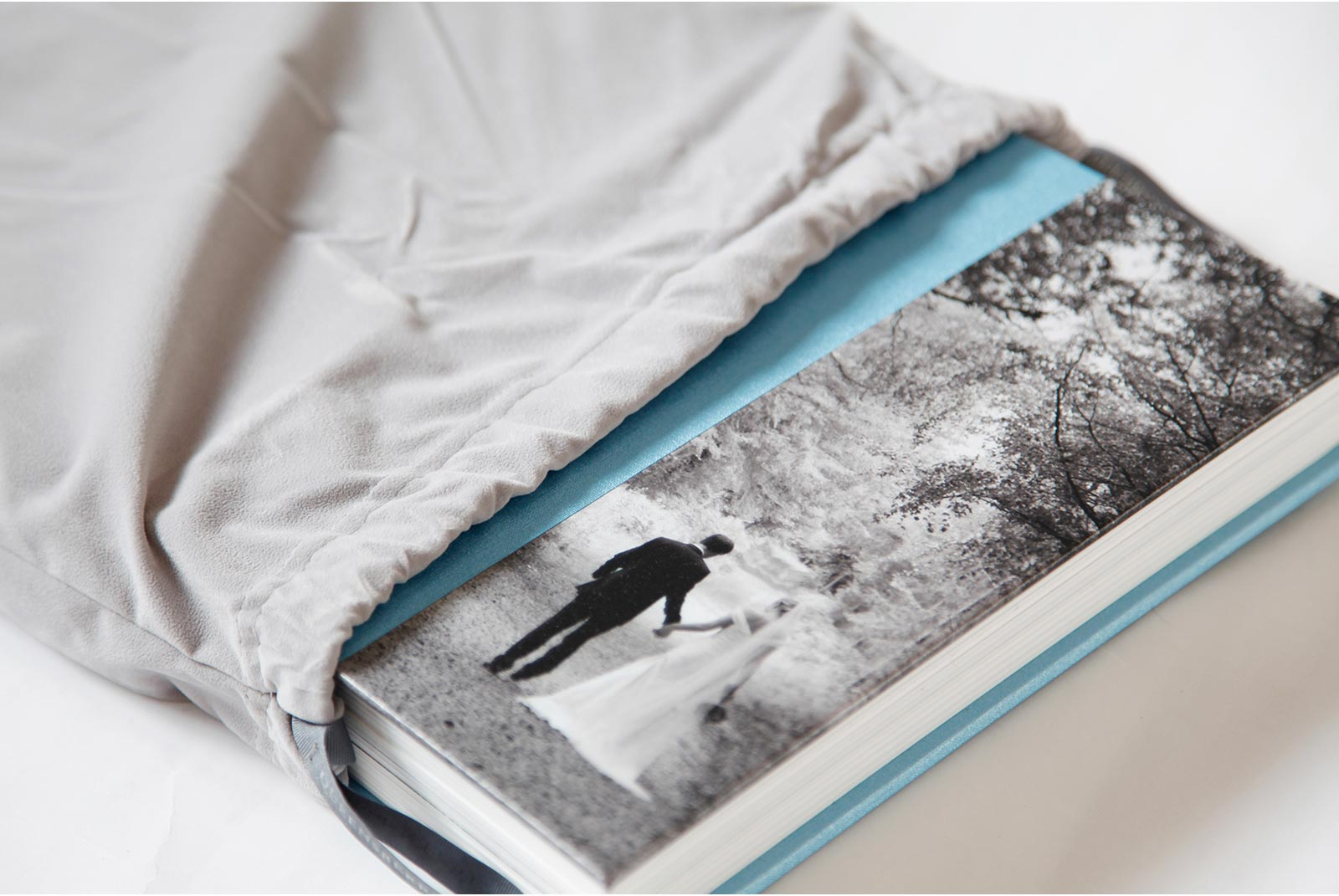Queensberry wedding album in baby blue classic library buckram with a quarter page photograph on the cover