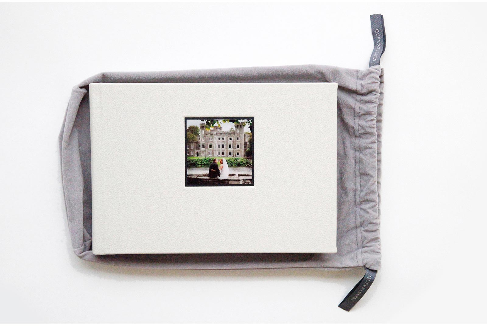 Small Queensberry wedding album wiht an eggshell micro leather cover and square photograph